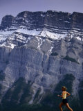 Woman Running in Front of Mountain, Banff, Canada Photographic Print by Woods Wheatcroft