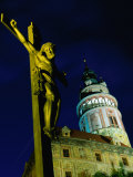 Statue of Christ on Cross with Round Tower of Cesky Krumlov Behind, Cesky Krumlov, Czech Republic Photographic Print by Richard Nebesky