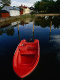 Red Boat Moored in Water with Houses in Background, Ekenas, Finland Photographic Print by Wayne Walton