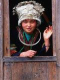 Shidong Miao Girl Wearing Silver Head Dress Looking Through a Window, Kaili, China Photographic Print by Keren Su