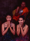 Monk Blessing Two Women at Angkor Wat, Angkor, Cambodia Photographic Print by Michael Coyne