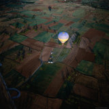 Aerial View of Hot Air Balloon Over Fields, Cappadocia, Turkey Photographic Print by Wes Walker