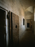 Doors to Cells along a Hallway in the Doges Palace Prison Photographic Print by Todd Gipstein