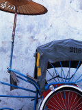 Detail of Rickshaw Leaning Against Wall on Cintra Street, Georgetown, Malaysia Photographic Print by Tom Cockrem