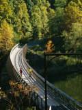 Cyclists Cross a Bridge on the Greenbrier Trail in West Virginia Photographic Print by Skip Brown