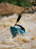 Kayaker Paddles Through Colorado River Rapids Photographic Print by Mark Cosslett