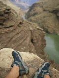 Feet Shod in River Shoes on an Overlook above the Colorado River Photographic Print by Bobby Model