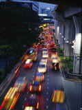 Evening Traffic on a Bangkok Street Photographic Print by Richard Nowitz