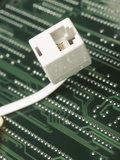 Telephone Jack on Computer Processor Photographic Print