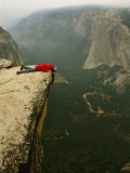 Prone Man Peers over Taft Point into the Yosemite Valley Photographic Print by Bill Hatcher