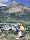 Boy Resting with Mountain Bike, Crested Butte, CO Photographic Print by Tom Stillo