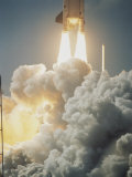 Fiery Exhaust Comes from the Booster Rocket Carrying the Columbia Photographic Print by Johnson & Peritore Schneeberger
