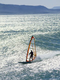 Windsurfer Silhouetted in the Sun on a Wave off Punta San Carlos Photographic Print by Skip Brown