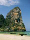 Boats and Rock Formation at Railey Beach on the Andaman Sea Coast Photographic Print by Mark Cosslett