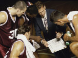 Basketball Team in a Huddle Photographic Print