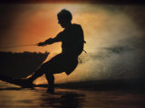 Silhouette of a Man Water Skiing Photographic Print