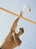 Low Angle View of a Young Man Playing Volleyball Fotografisk trykk