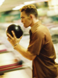 Side Profile of a Young Man Holding a Bowling Ball Photographic Print