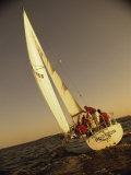 Group of People Sailing on a Sailboat Photographic Print