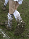 A Soccer Player's Muddy Cleats Photographic Print