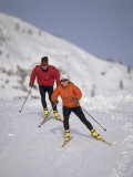 Colorful Couple Cross Country Skiing Photographic Print