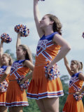 Side Profile of Cheerleaders with Pom-Poms Photographic Print