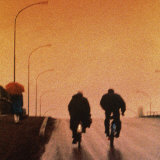 Bicycling Down Street Photographic Print