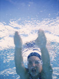 Close-up of a Young Man Swimming Underwater Photographic Print