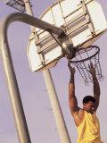 Young Man Playing Basketball Photographic Print