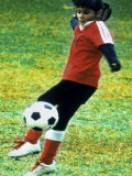 Young Female Soccer Player Photographic Print