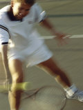 Young Man Playing Tennis Photographic Print