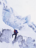 Man Climbing Snowy Mountain Photographic Print