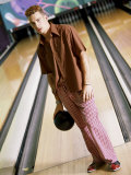 Young Man Standing at a Bowling Alley Photographic Print