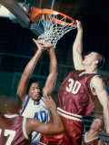 Basketball Player Slam Dunking a Basketball Photographic Print