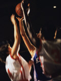 Young Women Reaching For a Basketball Photographic Print