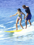 Man and Woman on a Surfboard Photographic Print