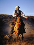 Cowboy on Running Horse with Whip Photographic Print by Inga Spence