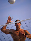 Young Man Playing Beach Volleyball Fotografisk trykk