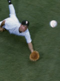 High Angle View of a Baseball Player Diving to Catch a Baseball Photographic Print