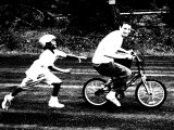 Teen Boy Stealing Younger Boy's Bicycle Photographic Print