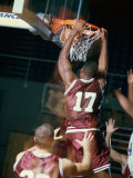 Rear View of a Basketball Player Slam Dunking Photographic Print