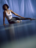 Young Woman Doing Yoga on the Floor Photographic Print