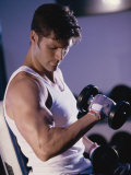 Young Man Exercising with Dumbbells Photographic Print