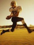 Football Player Running with The Ball Photographic Print