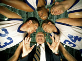Low Angle View of a Team and Their Coach in a Huddle Photographic Print