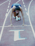 High Angle View of a Young Woman at The Starting Position of a Running Track Photographic Print