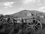 Old Wood Wagon near Mining Ghost Town at Bannack State Park, Montana, USA Photographic Print by John & Lisa Merrill