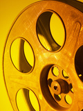 Movie Film and Reels in Yellow Light Photographic Print