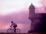 Cycling at El Morro in Old San Juan at Sunset, Puerto Rico Photographic Print by Greg Johnston