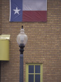 Texas Flag and Street Light, Lubbock, Texas, USA Photographic Print by Darrell Gulin
